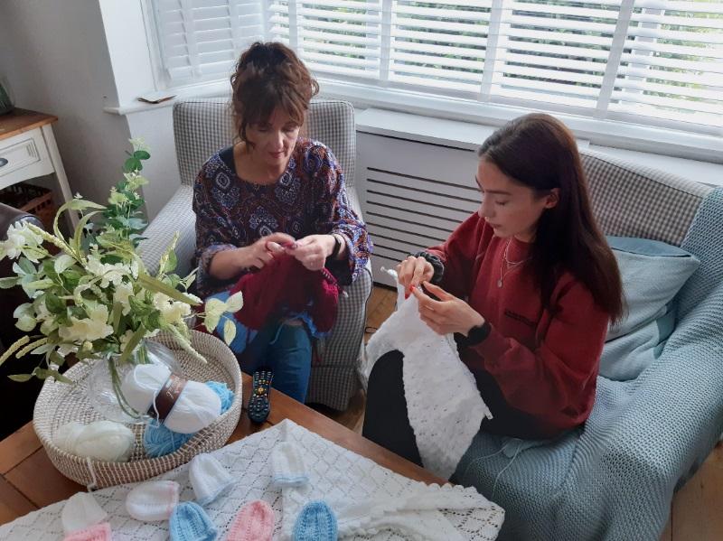 Ellen knitting with her mum