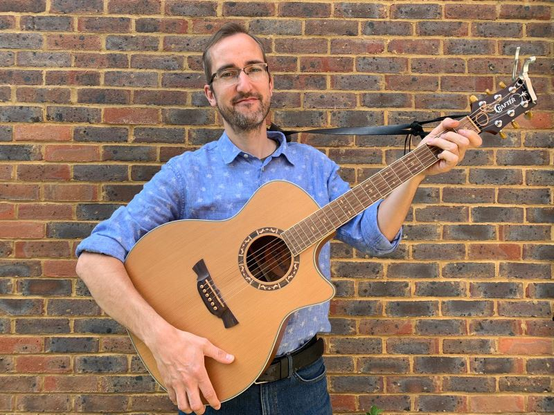 Martin with his guitar
