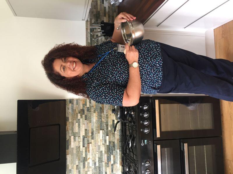 Samantha baking in her kitchen