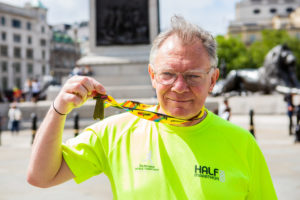 CAFOD runner celebrates completing the Half Marathon